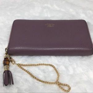 Authentic Preowned Gucci Purple Zippy